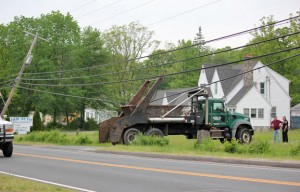 A dump truck snagged some wires and partially pulled down the telephone pole on the left along Union City Road in Prospect Wednesday afternoon. –ELIO GUGLIOTTI