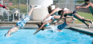 Swimmers dive into Hop Brook Pool in Naugatuck during the summer of 2007. Work on the pool, which has been closed since 2012, is one of four capital projects that will be voted on at a referendum in November. –RA ARCHIVE
