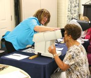 Yolanda Coyey gets her eyes tested by Healthy Eyes Alliance Program Director Naomi Haynor during the Naugatuck Senior Health and Wellness Clinic June 19 at the Naugatuck Senior Center. The annual clinic provides a variety of screenings to seniors. Senior center Director Harvey Frydman said center was able to host the clinic because of a $20,000 grant from the state and the donation of time and services from the Western Connecticut Area Agency on Aging. –LUKE MARSHALL