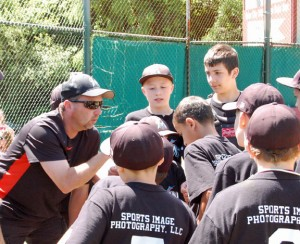 Union City Little League Marlins coach Dennis Sigetti fires up his team June 21 at the Joe Joy Complex in Naugatuck during a game versus the Peter J. Foley Little League Indians. The game was the first-ever meeting between the major division champions of the two borough Little Leagues. The Marlins won, 8-2. –KEN MORSE