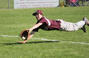 Naugatuck's Kyle Torok dives to try to catch a foul ball that falls just out of his reach June 2 versus East Hartford during the Class LL tournament in Naugatuck. Naugatuck won the game, 8-0. The Greyhounds followed up that victory with a walk-off win over Newtown June 3 in eight innings. Naugatuck will play in the Class LL quarterfinals Friday for the first time since 2000. –ELIO GUGLIOTTI