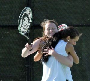 Woodland doubles partners Paige Gainey (facing the camera) and Daphne Cianciolo hug May 29 in Beacon Falls after winning their match versus the Naugatuck tandem of Chelsea Iglesias and Crystal Wooster 9-8 (7-4) following a tiebreaker. The win by Gainey and Cianciolo clinched the NVL girls team tennis tournament championship for the Hawks. –ELIO GUGLIOTTI