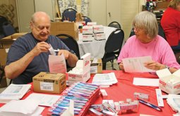 Arthur Anderson, left, and his wife Lynn fill dental kits July 16 at the Naugatuck Senior Center. The seniors filled over 2,000 kits with a toothbrush, a travel size tube of toothpaste and floss. Once they were filled the kits were distributed to expecting mothers by the Connecticut Dental Health Partnership. The seniors volunteer to fill these kits once a month. For more information, call the senior center at (203) 720-7069. –LUKE MARSHALL