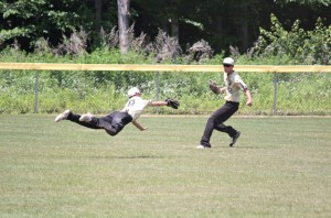 Posts 194-25's Kevin Gabinelli (8) makes a diving catch in centerfield as Dylan Cummings (42) backs him up June 29 in the first game of a doubleheader versus New Milford at Hotchkiss Park in Prospect. Prospect-Beacon Falls fell 7-5. Posts 194-25 bounced back with a 10-3 win in the second game and still has hopes of making the state tournament. –ELIO GUGLIOTTI