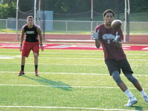 Naugatuck High School rising senior wide receiver Chris Quarles hauls in a pass July 22 at Naugatuck High during a NVL passing league game. The league was started this year by Naugatuck High football coach Craig Bruno. –RA ARCHIVE