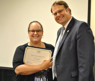 Erica Atchison of Naugatuck was awarded a scholarship by The Saint Mary's Hospital Foundation at a reception at the hospital June 25. Atchison is a medical assistant at Saint Mary's Urgent Care Center in Naugatuck and has been accepted into the nursing program at Naugatuck Valley Community College. Pictured with Atchison is Chad Wable, FACHE, president and chief executive officer of Saint Mary's Health System. –CONTRIBUTED