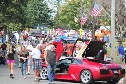 People and classic cars fill Center Street in Prospect last year during the annual Sock Hop and Car Show. This year's show is Sunday. –FILE PHOTO
