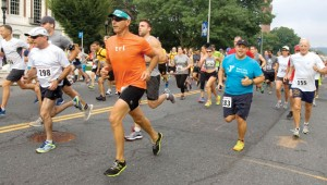 Runners take off up Grand Street during the Bob Veillette 5K Road Race in Waterbury Saturday. –RA ARCHIVE