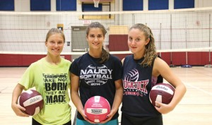 Naugatuck High volleyball captains, from left, seniors Kara Klimaszewski, Lauren Burns and Erika Andreoli will lead the Greyhounds on the court this year. –LUKE MARSHALL