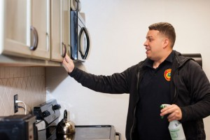 Naugatuck firefighter Todd Gallino shines up the new kitchen at the east side firehouse on May Street last week. Gallino led a project to install new tiles, countertops, ceiling boards and paint the cupboards at the firehouse. -REPUBLICAN-AMERICAN