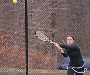 Woodland's Ally Mayne returns a shot during her match April 9 with Naugatuck's Sarah Cook in Beacon Falls. Woodland won the match, 4-3. The Hawks, the defending Naugatuck Valley League champions, started the defense of their title by winning their first four matches. –ELIO GUGLIOTTI