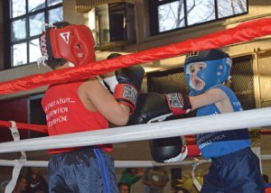 Jacob Trombley, right, boxes with Cory Murphy in April 2015 at the Naugatuck YMCA. The YMCA will rededicate its boxing room on Saturday in honor of Joe Triano and Joe Rossi. –KEN MORSE