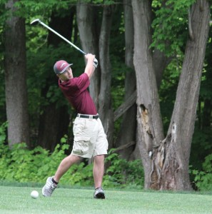 Naugatuck's P.J. Murphy, a captain of the golf team, tees off during a match earlier this year. –FILE PHOTO