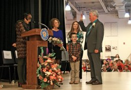 Prospect Mayor Robert Chatfield, right, is sworn in for his 20th term in office by U.S. Rep. Rosa DeLauro, left, as his wife Ginny, daughter Leslie, and grandson Zack look on Nov. 13 at Prospect Elementary School. –LUKE MARSHALL