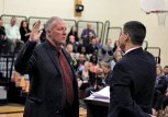 Naugatuck Mayor N. Warren 'Pete' Hess, left, is sworn in for his first term in office Nov. 17 by outgoing Mayor Robert Mezzo at Hillside Intermediate School. –ELIO GUGLIOTTI