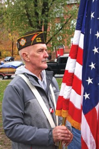 U.S. Army veteran Bryan Curtis holds the American flag during Naugatuck's Veterans Day ceremony Nov. 11 on the Green. –LUKE MARSHALL