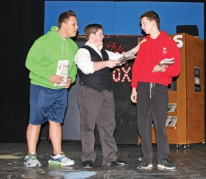 Naugatuck Teen Theater actors, from left, Josh Viltrakis, Alex Niatopsky and Billy Nicol rehearse a scene from the theater's upcoming performance of 'Guys and Dolls' Oct. 29 at St. Michael's Church in Naugatuck. The musical opens Saturday. –LUKE MARSHALL