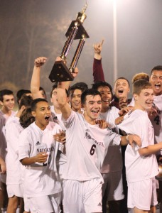Naugatuck's Candido Carrelo (6) hoists the NVL boys soccer tournament championship trophy as the Greyhounds celebrate after beating Woodland, 2-0, Nov. 5 at Municipal Stadium in Waterbury in the final. –ELIO GUGLIOTTI