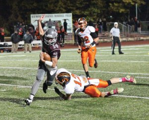 Naugatuck's Tyler Deitelbaum (14) eludes the tackle of Watertown's Kyle Sklanka (12) during the Greyhounds' 40-23 win over Watertown in Naugatuck Oct. 29. –ELIO GUGLIOTTI