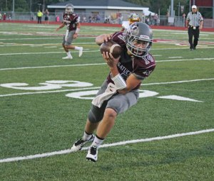 Naugatuck junior Tyler Deitelbaum provides the Greyhounds with a duel-threat on offense as a runner and receiver. Naugatuck heads into the annual Thanksgiving game versus Ansonia looking to shock the Chargers. –ELIO GUGLIOTTI