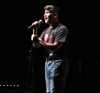 Naugatuck High student Luis Zamot sings 'Hello' by Adele Dec. 10 during the anti-bullying assembly 'Crossing the Line' at the school. The assembly is organized by the school's DECA chapter and presented to the entire sophomore class. The program featured information on the consequences of bullying and what students can do to deal with bullying. –ELIO GUGLIOTTI