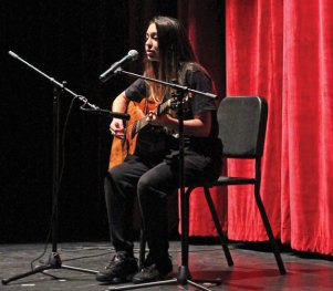 Naugatuck High student Samantha Mamudoski performs 'Back to Earth' by Justin Bieber Dec. 10 during the anti-bullying assembly 'Crossing the Line' at the school. The assembly is organized by the school's DECA chapter and presented to the entire sophomore class. The program featured information on the consequences of bullying and what students can do to deal with bullying. –ELIO GUGLIOTTI