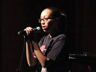 Naugatuck High student Esmeldy Hernandez sings 'Because of You' by Kelly Clarkson Dec. 10 during the anti-bullying assembly 'Crossing the Line' at the school. The assembly is organized by the school's DECA chapter and presented to the entire sophomore class. The program featured information on the consequences of bullying and what students can do to deal with bullying. Hernandez was accompanied by Emily Kropo on the piano. –ELIO GUGLIOTTI