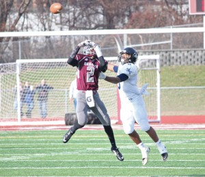 Naugatuck's Etty Ilunga (2) breaks up a pass intended for Ansonia's Tyler Bailey (5) Thanksgiving morning in Naugatuck. Ansonia won, 41-8. –ELIO GUGLIOTTI