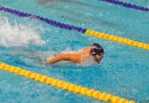 Naugatuck's Nick Ryan swims the 100 butterfly Dec. 22 versus Kennedy in Waterbury. Ryan won the event in 1:05.54, and the Greyhounds won the meet, 80-68. –KEN MORSE