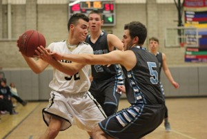Woodland's Rich Rousseau (32) looks for room to work as Oxford's Alec Golding (5) defends him and Oxford's Cole Chudoba (2) closes in Monday night in Beacon Falls. Oxford won the game, 70-33. –ELIO GUGLIOTTI