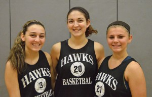 Woodland girls basketball captains, from left, Jill Chicano, Carla Piccolo and Cam Caswell will lead the Hawks on the court. –KEN MORSE