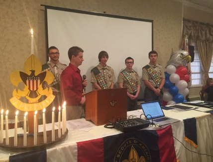 Michael Ahlberg, an Eagle Scout from Troop 60 in Southbury, leads a group of new Eagle Scouts in the rendition of the Eagle Scout Promise Dec. 6 in Naugatuck. Troop 138 held its Eagle Court of Honor ceremony in Naugatuck and bestowed the rank of Eagle Scout upon, from left, Nicholas Ryan, 17, of Naugatuck, Charles Fogie, 17, of Prospect, James DeBisschop, 15, of Naugatuck, and Matthew Hopkinson, 17, of Beacon Falls. As part of their preparation to become Eagle Scouts, the teens had to complete service projects that contribute to the betterment of the community. DeBisschop's project included renovating more than 100 feet of landscaping in front of the Naugatuck Congregational Church on Division Street. Fogie constructed a bridge over a stream that runs into Baummer's Pond on Mill Street in Naugatuck. Hopkinson built a pavilion at Toby's Pond in Beacon Falls. Ryan constructed three raised beds to grow fresh vegetables for clients of the Ecumenical Food Bank of Naugatuck and Beacon Falls on Spring Street in Naugatuck. He also cleaned up and landscaped the area around the food bank headquarters. –REPUBLICAN-AMERICAN