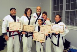 Five members of USA Martial Arts in Naugatuck were promoted at a Black Belt grading Nov. 20 at the Wolcott Youth Center. Pictured, from left, Marlon Nascimento and Connor Reese were promoted to 1st Dan Black, Grand Master Robert Cheezic, Lauren Mulinski, Jessica Gallagher and Karli Butcher were promoted to 2nd Dan Black Belt. -CONTRIBUTED