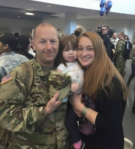 Army National Guard Sgt. 1st Class Glen Francouer, of Beacon Falls, is welcomed home by home by his wife, Meghan (Neal) Francouer, and their 2-year-old daughter, Clara, on Wednesday. -CONTRIBUTED