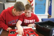 Fifth-graders Brian O'Connell, left, and Zachary Renaud sort through Lego pieces while building a Lego robot Jan. 14 at Beacon Falls Town Hall as part of the Beacon Falls Library's Lego Robotics program. –LUKE MARSHALL