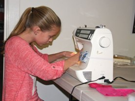 Katherine Foley, 10, of Prospect, uses a sewing machine sewing program at the Prospect Library Dec. 31. –LUKE MARSHALL