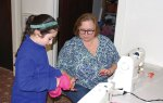 Carol Johnson, of Bethany, helps Ava Laudadio, 9, of Prospect, with making a stuffed animal during a sewing program at the Prospect Library Dec. 31. –LUKE MARSHALL