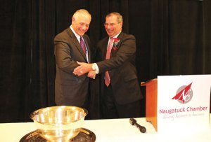 Incoming Naugatuck Chamber of Commerce Board of Directors Chairman Ron Pugliese, left, presents the Dibble Award to Naugatuck Valley Savings and Loan President and CEO William Calderara Tuesday night during the chamber's annual meeting at the Crystal Room in Naugatuck. –LUKE MARSHALL