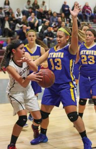 Naugatuck's Molly Kennedy, left, passes the ball around Seymour's Mia Pinto (13) Jan. 13 in Naugatuck. Seymour won the game, 45-41. –ELIO GUGLIOTTI