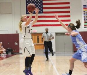 Naugatuck's Andrea Mercer (42) shoots as Oxford's Emily Smith (24) runs in to defend Jan. 8 in Naugatuck. Naugatuck won the game, 40-16. –ELIO GUGLIOTTI
