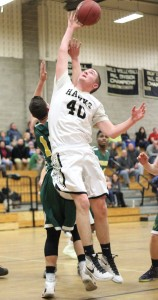 Woodland's Eric Beutel (40) battles with Holy Cross' Justin Strielkauskas for a rebound Tuesday night in Beacon Falls. Holy Cross won, 92-63. –ELIO GUGLIOTTI
