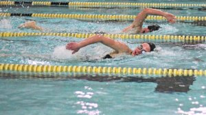 Woodland's Julie Hinckley, front, and Naugatuck's Martin Lippai are neck and neck in the 500 freestyle Jan. 20 in Beacon Falls. Naugatuck won the meet, 92-83. –ELIO GUGLIOTTI