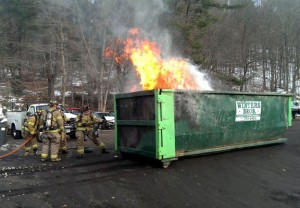 Members of the Beacon Hose Co. No. 1 in Beacon Falls prepare to extinguish a dumpster fire at South Main Street and Noe Place Friday afternoon. -CONTRIBUTED