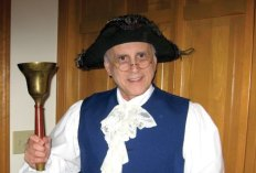 Naugatuck Historical Society member Ron Gagliardi portrays a town crier during a presentation on the story of Chauncey Judd to seventh-grade social studies students at City Hill Middle School in January. Social studies teacher Annette Caselli coordinated the presentation with members of the Naugatuck Historical Society, including Bridget Mariano, Wendy Murphy, Sandra Clark, Budd Cushman and Gagliardi. Students played the parts of the characters and afterward asked questions about the event. -DIANE GAGLIARDI