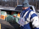 Prospect Republican Town Committee member Nazih Noujaim stands by a truckload of food items and cash collected during the committee's annual Open Your Heart Valentine Day's collection drive Feb. 13 at Oliver's Supermarket. The drive was cut short due to the frigid temperatures. The food was donated to the Prospect Food Bank and nearly $400 was raised for the Prospect Fuel Fund. Additional donations can be sent directly to Prospect Town Hall. –CONTRIBUTED