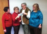 Naugatuck Woman's Club President Laura Smith, second from the left, presents a check to Betty Proulx to help pay to renovate the bathroom in the home of Proulx's granddaughter, Kaley Langzettel, who has RETT syndrome, to make it more accessible. Pictured with Smith and Proulx are club member Mary Santos, left, and club Treasurer Beverly Hudson. –CONTRIBUTED