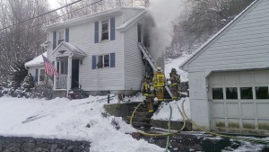 Firefighters work to put out a fire Saturday at 70 Melbourne Court in Naugatuck. –CONTRIBUTED
