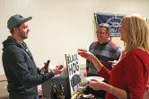 Stuart Slocum, left, of Black Hog Brewing Company in Oxford, hands samples of beer to Ellen Shugrue, right, and Greg Shugrue, of Middlebury, Feb. 13 during the Naugatuck Historical Society's annual Savor CT at the Naugatuck Elks Lodge. The event featured samples of food and alcohol made in Connecticut. About 190 tickets were sold for the event, which was more than double last year's ticket sales, according to historical society Treasurer Wendy Murphy. –LUKE MARSHALL