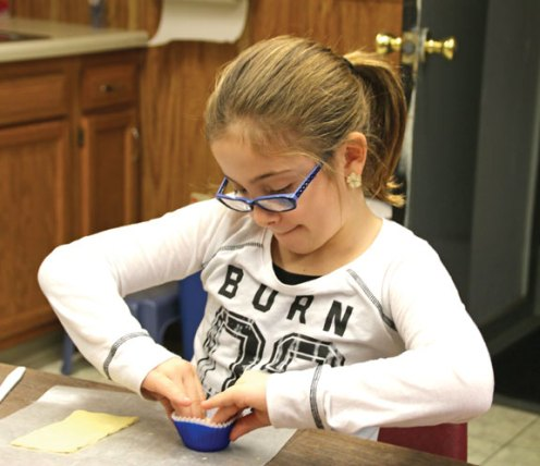 Jayden Wood, 8, of Naugatuck makes a meatball muffin a cooking class run by the Naugatuck Parks and Recreation Department Jan. 21. –LUKE MARSHALL