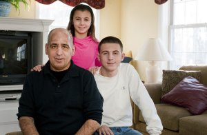 Joe DePalma with his children Jessie, 11, and Josh, 16, inside their Prospect home. Joe's wife, Karen DePalma, died from cancer a few years ago. When she was sick, Joe was also diagnosed with cancer. Friends hold a 3-on-3 basketball tournament to help raise money for the family; this year's event will be held March 19. -REPUBLICAN-AMERICAN